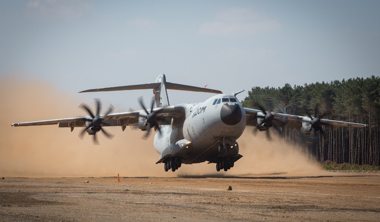An Airbus A400M performs a dirt airstrip take off.