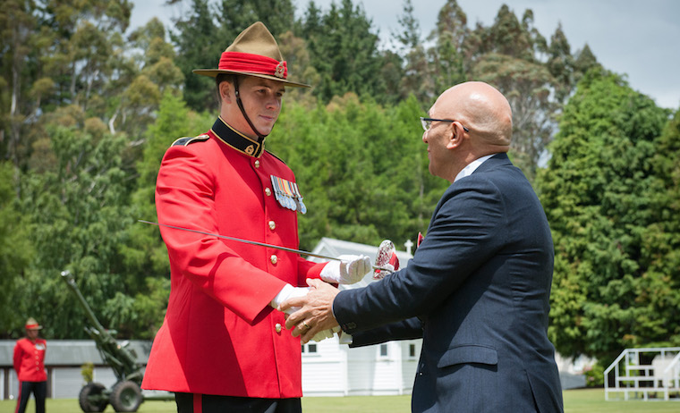 Minister presents the Sword of Honour to 2LT Mitch Lennane at the Army's New Zealand Commissioning Course graduate parade at Waiouru Camp, 9 December 2017.